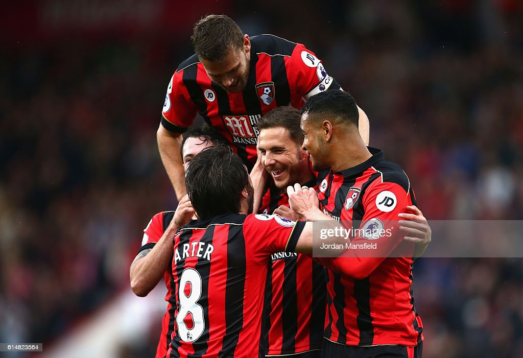 Dan Gosling of AFC Bournemouth (C) celebrates scoring his sides sixth goal during the Premier League match between AFC Bournemouth and Hull City at Vitality Stadium on October 15, 2016 in Bournemouth, England.