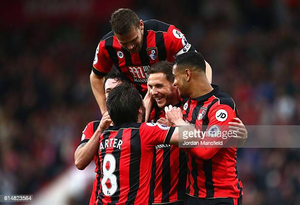 Dan Gosling of AFC Bournemouth celebrates scoring his sides sixth goal during the Premier League match between AFC Bournemouth and Hull City at...