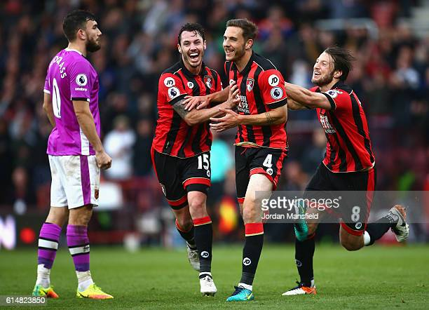 Dan Gosling of AFC Bournemouth celebrates scoring his sides sixth goal with Adam Smith of AFC Bournemouth and Harry Arter of AFC Bournemouth during...