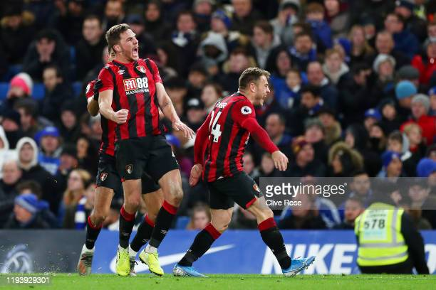 Dan Gosling of AFC Bournemouth celebrates with teammates after scoring his team's first goal during the Premier League match between Chelsea FC and...