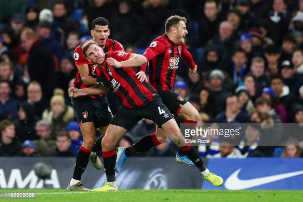 Dan Gosling of AFC Bournemouth celebrates with teammates Dominic Solanke and Ryan Fraser of AFC Bournemouth after scoring their teams first goal...