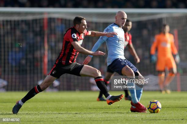 Dan Gosling of AFC Bournemouth chases down Jonjo Shelvey of Newcastle United during the Premier League match between AFC Bournemouth and Newcastle...