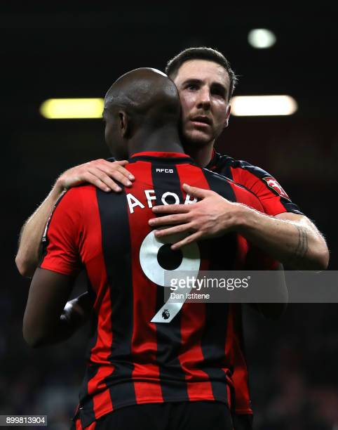 Dan Gosling of AFC Bournemouth embraces teammate Benik Afobe after the Premier League match between AFC Bournemouth and Everton at Vitality Stadium...