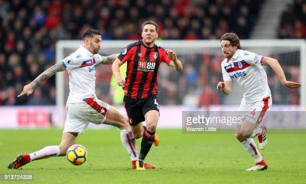 Dan Gosling of AFC Bournemouth escapes a challenge from Geoff Cameron of Stoke City during the Premier League match between AFC Bournemouth and Stoke...