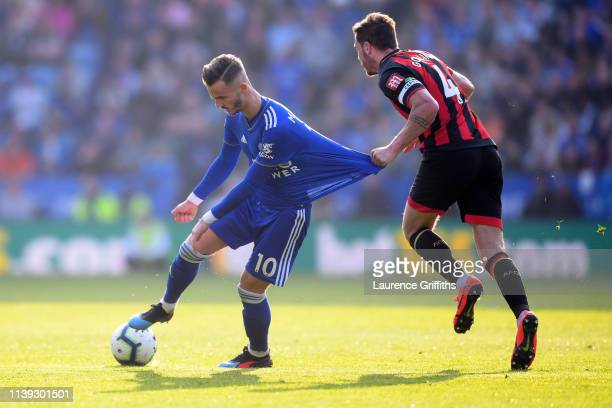 Dan Gosling of AFC Bournemouth holds onto the shirt of James Maddison of Leicester City during the Premier League match between Leicester City and...