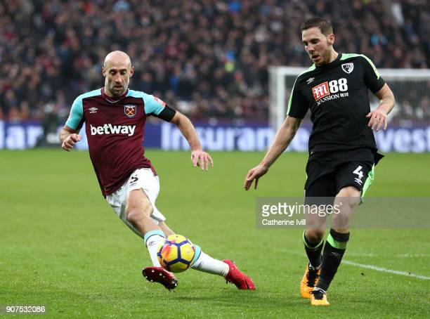 Dan Gosling of AFC Bournemouth is challenged by Pablo Zabaleta of West Ham United during the Premier League match between West Ham United and AFC...