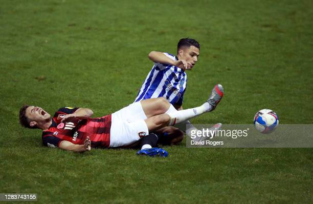 Dan Gosling of AFC Bournemouth is tackled by Joey Pelupessy of Sheffield Wednesday during the Sky Bet Championship match between Sheffield Wednesday...