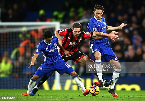 Dan Gosling of AFC Bournemouth is tackled by Pedro and Nemanja Matic of Chelsea during the Premier League match between Chelsea and AFC Bournemouth...