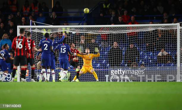 Dan Gosling of AFC Bournemouth scores his team's first goal over Kepa Arrizabalaga of Chelsea after it was reviewed by VAR during the Premier League...