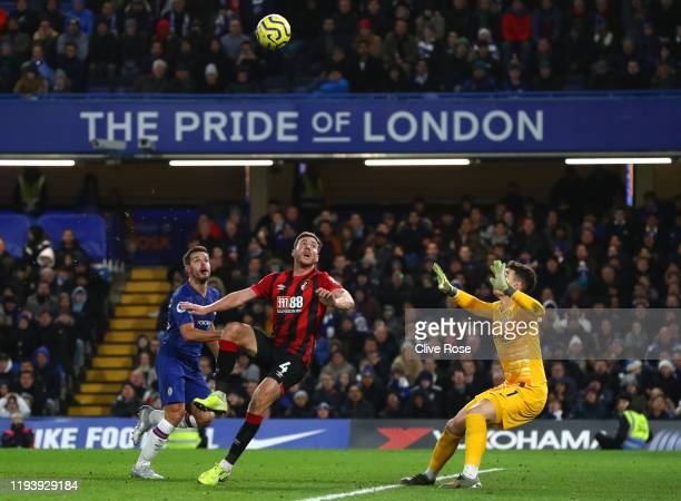 Dan Gosling of AFC Bournemouth scores his team's first goal which is given following a VAR check during the Premier League match between Chelsea FC...