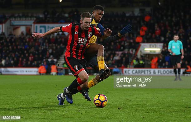 Dan Gosling of Bournemouth and Alex Iwobi of Arsenal during the Premier League match between AFC Bournemouth and Arsenal at Vitality Stadium on...