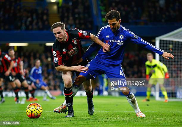 Dan Gosling of Bournemouth and Cesc Fabregas of Chelsea compete for the ball during the Barclays Premier League match between Chelsea and AFC...