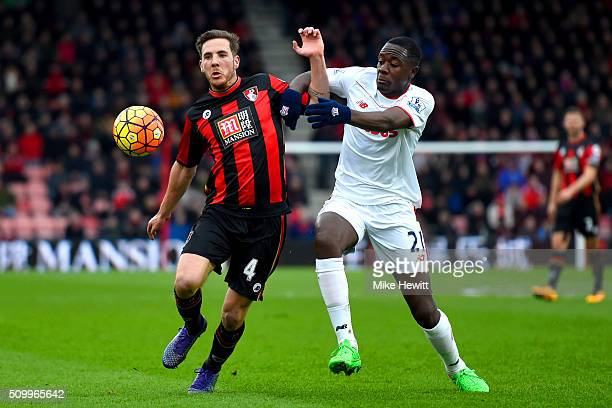 Dan Gosling of Bournemouth and Giannelli Imbula of Stoke City compete for the ball during the Barclays Premier League match between AFC Bournemouth...