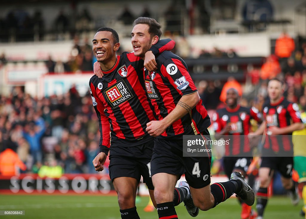 Dan Gosling (R) of Bournemouth celebrates scoring his team's first goal with his team mate Junior Stanislas (L)during the Barclays Premier League match between A.F.C. Bournemouth and Norwich City at the Vitality Stadium on January 16, 2016 in Bournemouth, England.