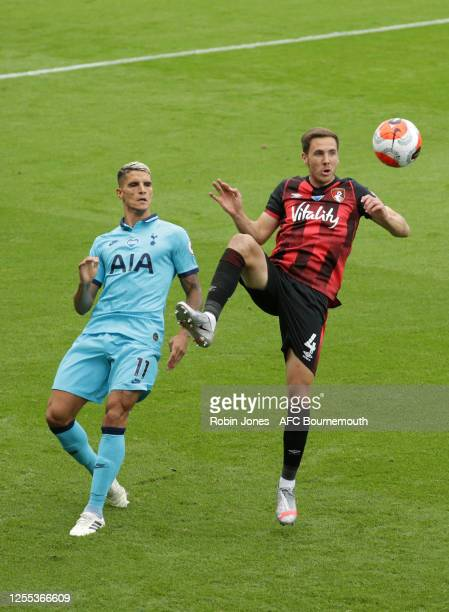 Dan Gosling of Bournemouth clears from Erik Lamela of Tottenham Hotspur during the Premier League match between AFC Bournemouth and Tottenham Hotspur...