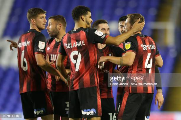 Dan Gosling of Bournemouth is congratulated by team-mates after he scores a goal to make it 3-1 during the Sky Bet Championship match between...