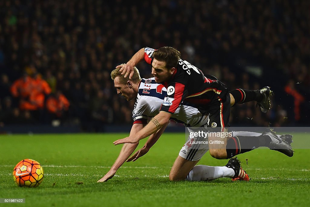 Dan Gosling of Bournemouth is fouled by Darren Fletcher of West Bromwich Albion in the penalty area during the Barclays Premier League match between West Bromwich Albion and A.F.C. Bournemouth at The Hawthorns on December 19, 2015 in West Bromwich, England.