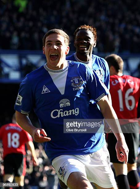 Dan Gosling of Everton celebrates scoring his teams second goal with Louis Saha during the Barclays Premier League match between Everton and...