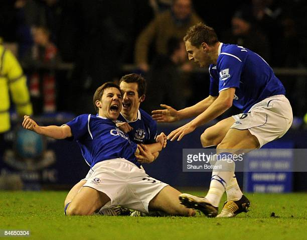 Dan Gosling of Everton is congratulated by teammate Leighton Baines and Phil Jagielka after scoring during the FA Cup Sponsored by Eon 4th Round...