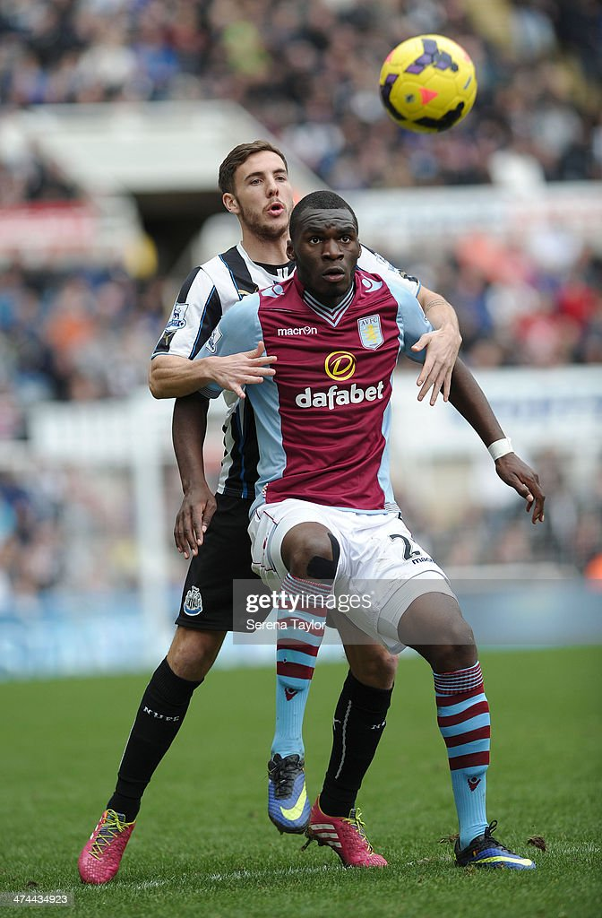 Dan Gosling of Newcastle challenges Aston Villa's Christian Benteke for the ball during the Barclays Premier League match between Newcastle United and Aston Villa at St. James' Park on February 23, 2014, in Newcastle upon Tyne, England.