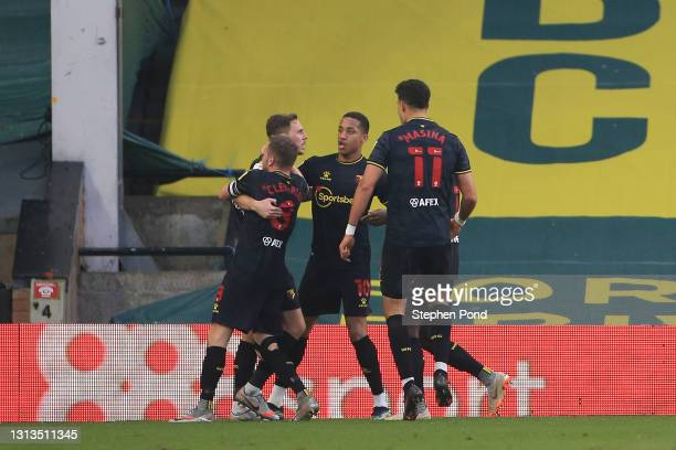 Dan Gosling of Watford FC celebrates with teammates after scoring their team's first goal during the Sky Bet Championship match between Norwich City...