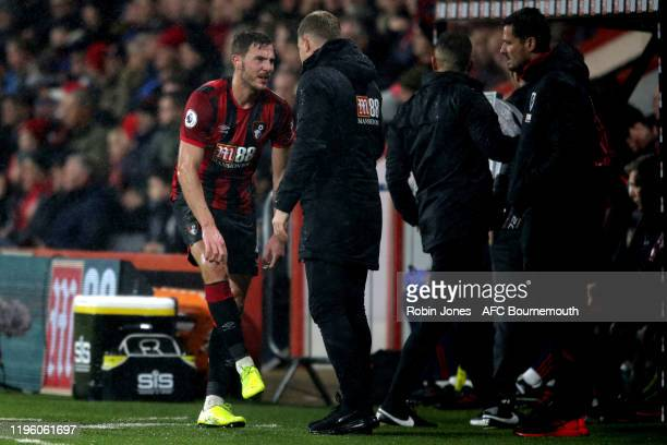 Dan Gosling with Eddie Howe of Bournemouth after Gosling goes off injured during the Premier League match between AFC Bournemouth and Arsenal FC at...