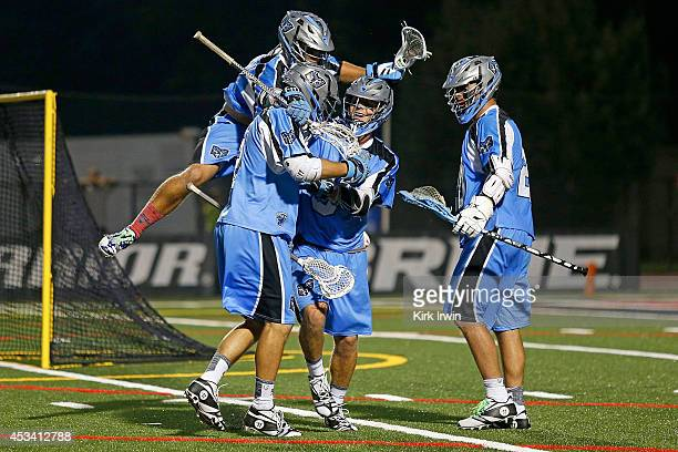 Dan Groot of the Ohio Machine is congratulated by his teammates after scoring a goal against the Florida Launch during the fourth quarter on August 9...