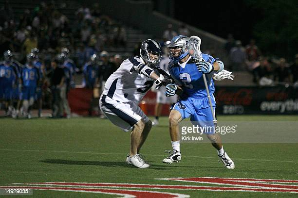 Dan Groot of the Ohio Machine runs the ball past Matt Abbott of the Chesapeake Bayhawks on July 21 2012 at Selby Stadium in Delaware Ohio
