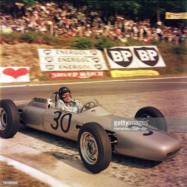 Dan Gurney rounding Nouveau Monde hairpin with his usual openmouthed expression during the French Grand Prix at Rouenles Essarts 8th July 1962 Taken...