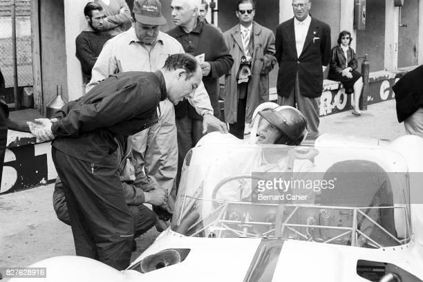 Dan Gurney Stirling Moss 1000 Km of of Nurburgring Nurburgring 22 May 1960 Stirling Moss talking to his teammate Dan Gurney the pair won the race...