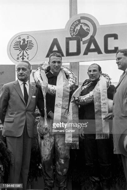 Dan Gurney, Stirling Moss, Nürburgring 1000 Kilometres, Nurburgring Nordschleife, 22 May 1960. Dan Gurney and Stirling Moss on the podium after their...