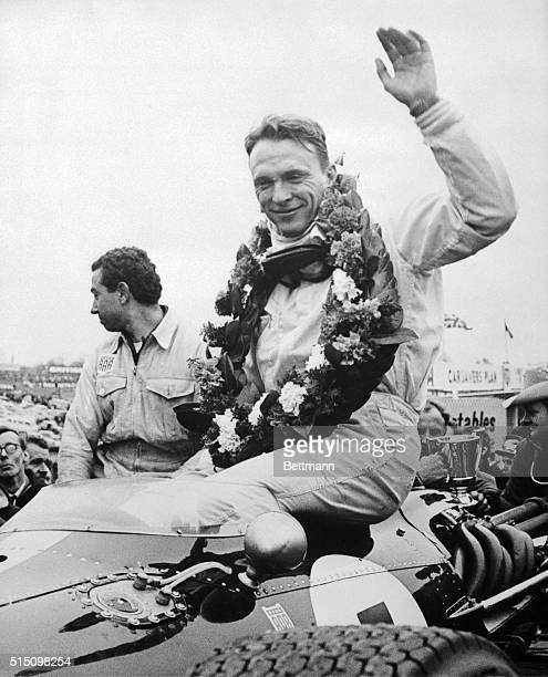 Dan Gurney waving to fans after winning the 1967 Formula One Race of Champions in Brands Hatch England