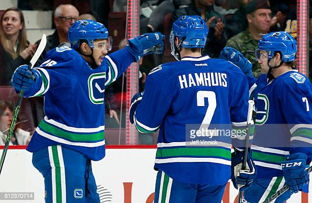 Dan Hamhuis and Linden Vey congratulate Emerson Etem of the Vancouver Canucks who scored against the Ottawa Senators during their NHL game at Rogers...
