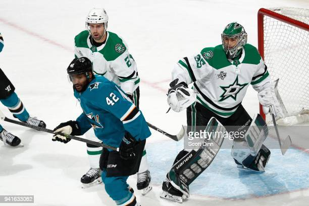 Dan Hamhuis and Mike McKenna of the Dallas Stars defend Joel Ward of the San Jose Sharks at SAP Center on April 3 2018 in San Jose California