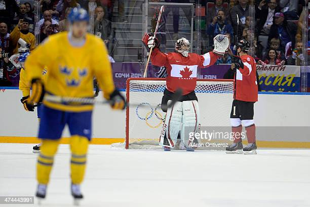 Dan Hamhuis of Canada and Carey Price celebrate during the third period of Canada's 30 win in the men's ice hockey gold medal game against Sweden...