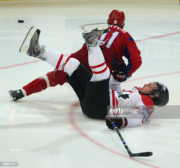Dan Hamhuis of Canada crashes in to Oleg Saprykin of Russia during the IIHF World Championship Final between Canada and Russia at the PostFinance...