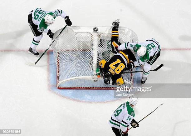 Dan Hamhuis of the Dallas Stars checks Sidney Crosby of the Pittsburgh Penguins knocking the net over onto goaltender Kari Lehtonen of the Dallas...