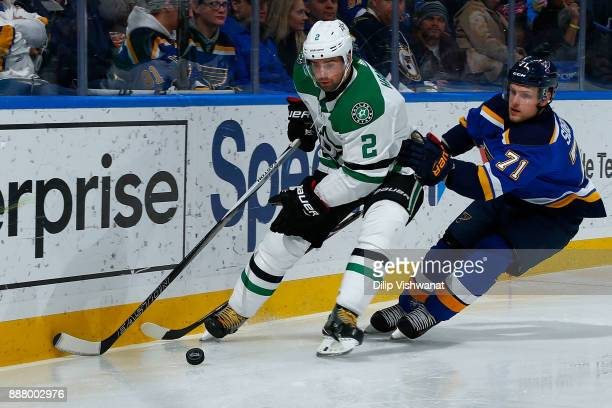 Dan Hamhuis of the Dallas Stars looks to beat Vladimir Sobotka of the St Louis Blues to the puck at Scottrade Center on December 7 2017 in St Louis...