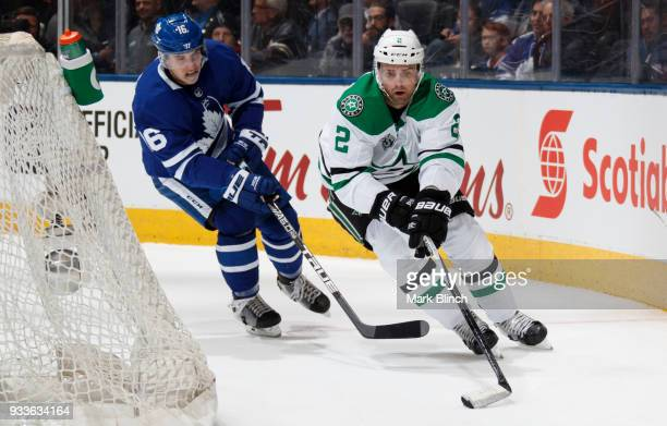 Dan Hamhuis of the Dallas Stars skates against Mitchell Marner of the Toronto Maple Leafs during the first period at the Air Canada Centre on March...