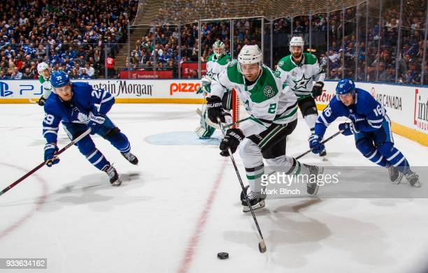 Dan Hamhuis of the Dallas Stars skates against William Nylander and Mitchell Marner of the Toronto Maple Leafs during the first period at the Air...