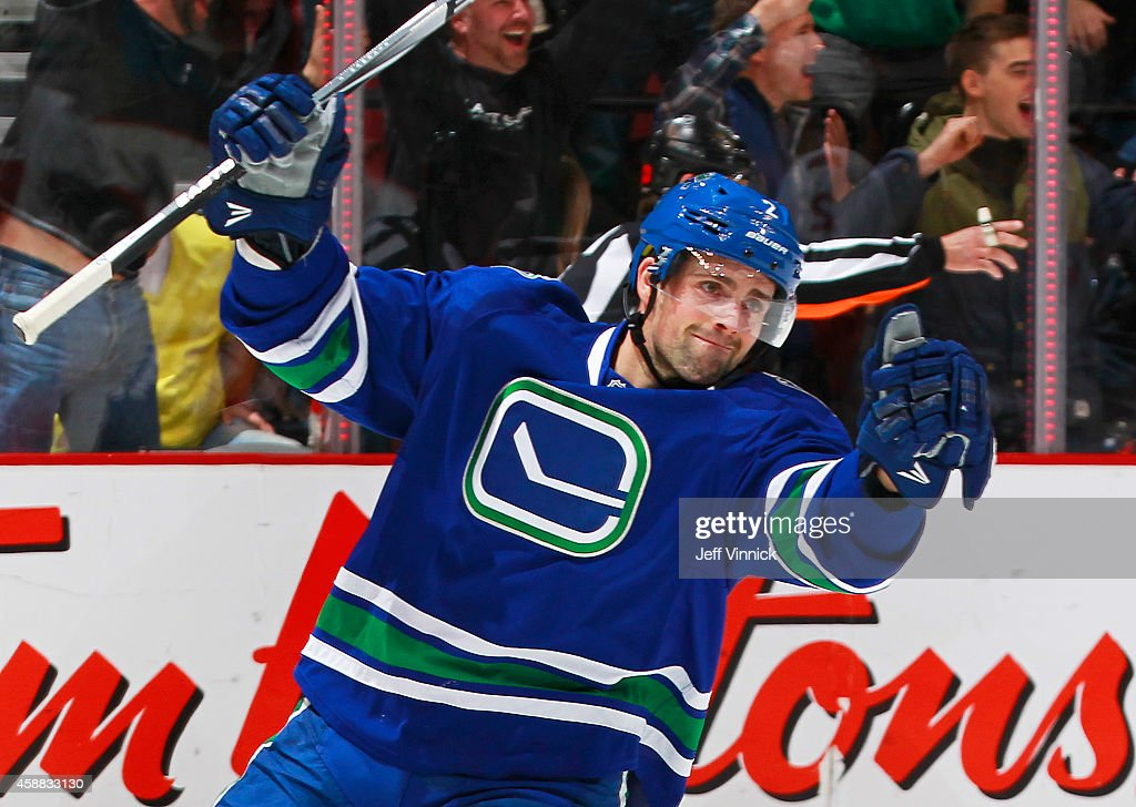 Dan Hamhuis #2 of the Vancouver Canucks celebrates the winning goal against the Ottawa Senators during their NHL game at Rogers Arena November 11, 2014 in Vancouver, British Columbia, Canada. Vancouver won 4-3 in overtime.