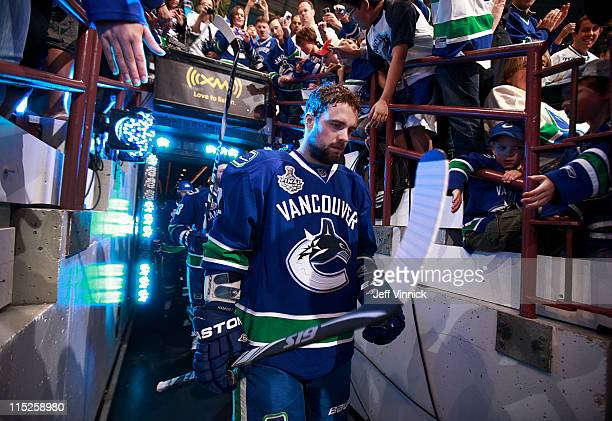 Dan Hamhuis of the Vancouver Canucks walks to the ice during Game One of 2011 NHL Stanley Cup Finals against the Boston Bruins at Rogers Arena on...