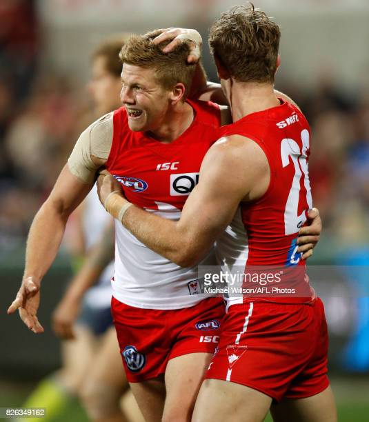 Dan Hannebery and Luke Parker of the Swans celebrate during the 2017 AFL round 20 match between the Geelong Cats and the Sydney Swans at Simonds...