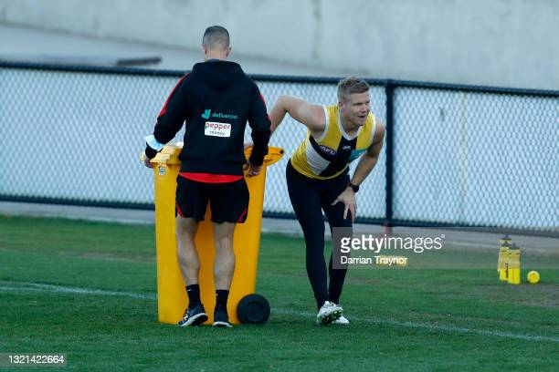 Dan Hannebery of the Saints stretches during a St Kilda Saints AFL training session at RSEA Park on June 03, 2021 in Melbourne, Australia.