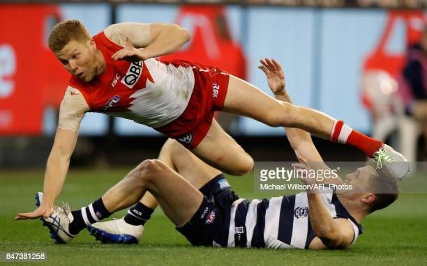 Dan Hannebery of the Swans and Joel Selwood of the Cats collide during the 2017 AFL Second Semi Final match between the Geelong Cats and the Sydney...