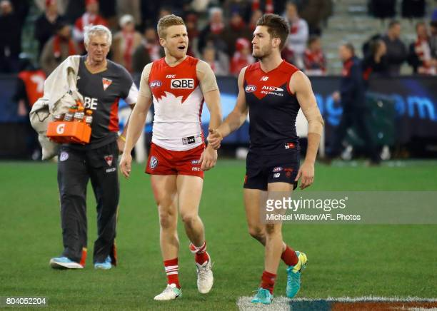 Dan Hannebery of the Swans and Tomas Bugg of the Demons speak after the 2017 AFL round 15 match between the Melbourne Demons and the Sydney Swans at...