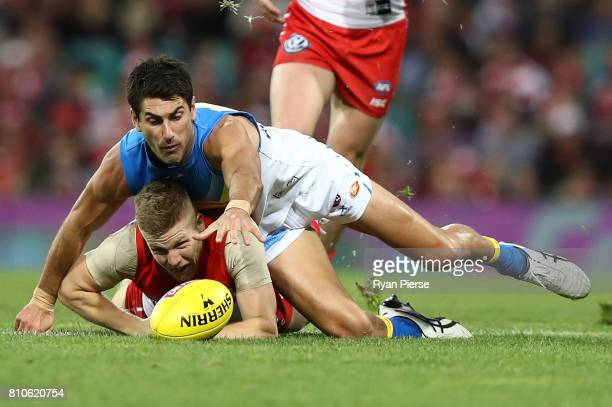 Dan Hannebery of the Swans competes for the ball against Matt Rosa of the Suns during the round 16 AFL match between the Sydney Swans and the Gold...