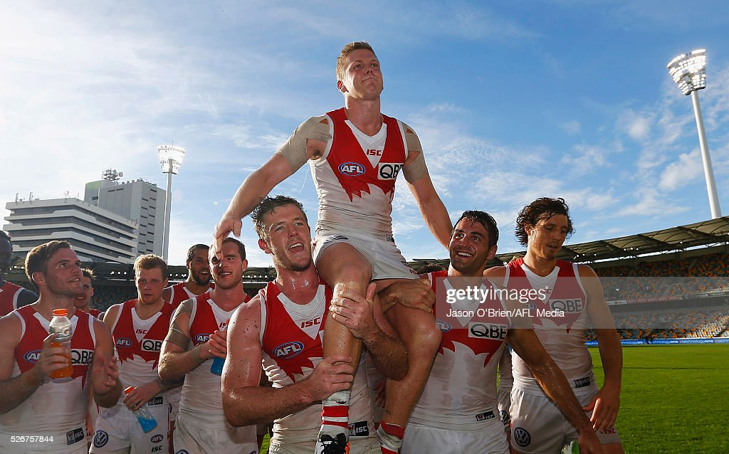 Dan Hannebery of the swans is chaired off during the round six AFL match between the Brisbane Lions and the Sydney Swans at The Gabba on May 1, 2016 in Brisbane, Australia.