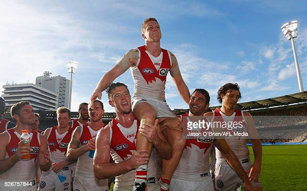 Dan Hannebery of the swans is chaired off during the round six AFL match between the Brisbane Lions and the Sydney Swans at The Gabba on May 1 2016...