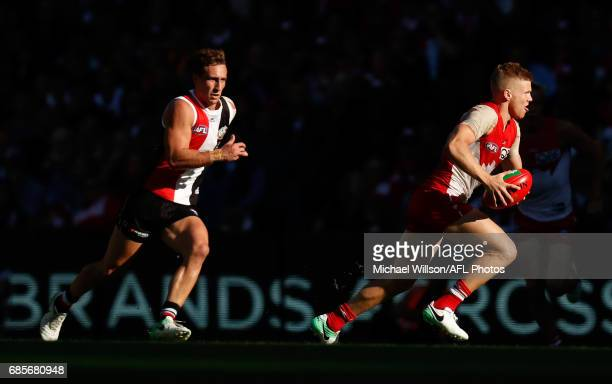 Dan Hannebery of the Swans is chased by Luke Dunstan of the Saints during the 2017 AFL round 09 match between the St Kilda Saints and the Sydney...